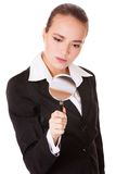 Attentive business woman with loupe Royalty Free Stock Images