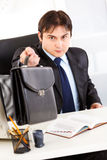 Attentive businessman giving briefcase Stock Photo