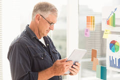 Attentive businessman looking at his tablet Stock Photos
