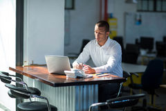 Attentive businessman working at desk. In office Royalty Free Stock Photo
