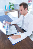 Attentive businessman working with flow charts. At office stock photography