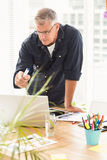 Attentive businessman working on a laptop Royalty Free Stock Photo