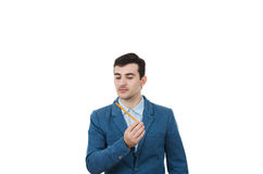 Attentive businessman. Young businessman man thinking about oportunities while holding a pencil in his hand.Idea Concept isolated on white background Stock Photos