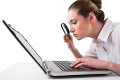 Attentive businesswoman typing on laptop Royalty Free Stock Image
