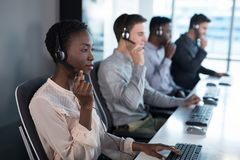 Customer service executives working at office royalty free stock photography