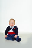 Attentive cute little baby boy in tuxedo Stock Photos