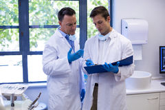 Attentive dentists discussing reports Royalty Free Stock Images