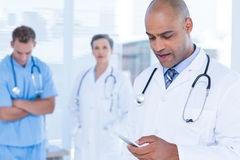 Attentive doctor sending a text message Royalty Free Stock Images