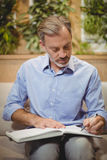 Attentive doctor writing in organizer Stock Images