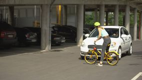 Attentive driver slamming on brakes before teenager on bicycle, traffic law stock footage