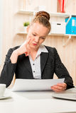 Attentive economist documents analyzing the financial condition Royalty Free Stock Image