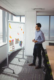 Attentive executive looking at whiteboard royalty free stock photo