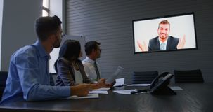 Executives making video conferencing in office 4k. Attentive executives making video conferencing in office 4k stock footage