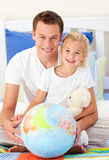 Attentive father and his daughter at home Stock Photos