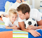 Attentive father and his son playing with a ball Royalty Free Stock Images