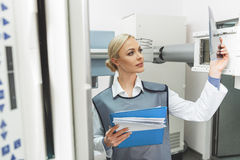 Attentive female doctor in roentgen room Royalty Free Stock Images