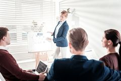 Attentive four colleagues numbering profits royalty free stock image