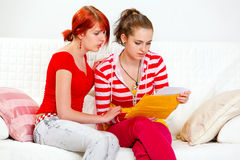 Attentive girl soothing reading letter girlfriend Royalty Free Stock Photos