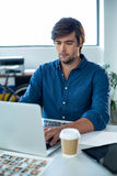 Attentive graphic designer working on laptop Stock Images