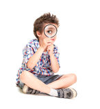 Attentive little boy with weird. Hair researching using magnifier isolated on white Stock Images