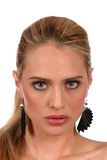 Attentive look of beautiful blond woman with grey eyes - portra. It royalty free stock photo