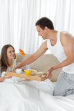 Attentive man bringing the breakfast to his wife Stock Photo
