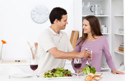 Attentive man serving salad to his girlfriend Stock Image