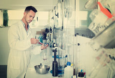 Attentive man testing wine qualities. In manufactory chemical laboratory Stock Photos