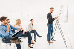 Attentive man writing on board Stock Photos