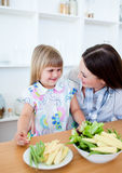Attentive mother and her daughter in the kitchen Royalty Free Stock Images