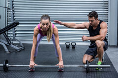 Attentive muscular woman lifting weight Royalty Free Stock Photo