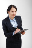Attentive office worker writing in the folder. Royalty Free Stock Photos