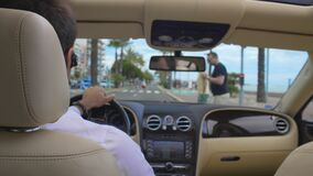 Attentive private chauffeur stopping car before crosswalk, traffic light, rules. Stock footage stock video