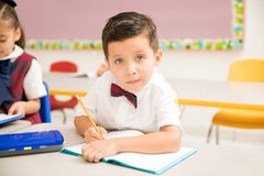 Attentive pupil doing his work on preschool royalty free stock photography