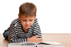 Attentive reading boy Royalty Free Stock Image