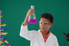 Attentive schoolboy doing a chemical experiment in laboratory. At school Royalty Free Stock Photo