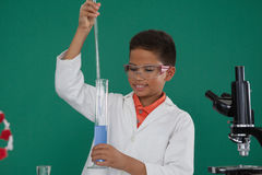 Attentive schoolboy doing a chemical experiment in laboratory. At school Stock Photo