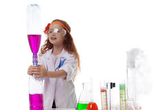 Attentive schoolgirl conducting experiment Stock Image