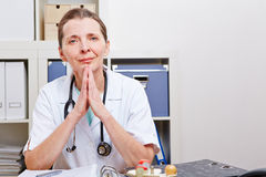 Attentive senior doctor in her Royalty Free Stock Photos