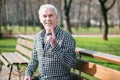 Attentive senior man warning Royalty Free Stock Image