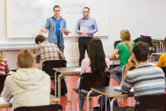 Attentive students with teacher in the classroom Royalty Free Stock Image