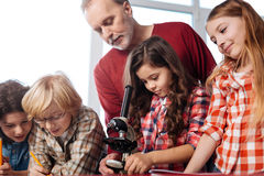 Attentive teacher monitoring the experiment Royalty Free Stock Photography