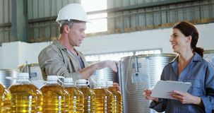 Workers working at factory. Attentive workers working at factory stock video footage