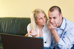 Attentive young couple. Stock Photos