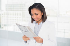 Attentive young dark haired businesswoman reading a document Royalty Free Stock Photography