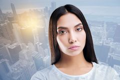 Attentive young female showing her emotions. Deep stare. Thoughtful woman posing on camera while working in model agency Royalty Free Stock Photo