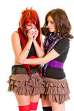 Attentive young girl calming her sad girlfriend Stock Photography