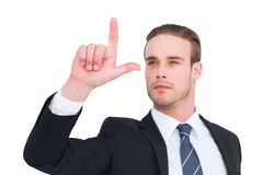 Attentively businessman in suit pointing up Royalty Free Stock Images