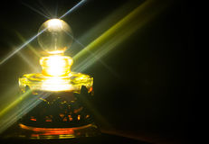 Atter bottle. Atter perfume bottle with light reflection Royalty Free Stock Image