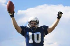 Atterraggio del giocatore di football americano Immagine Stock Libera da Diritti